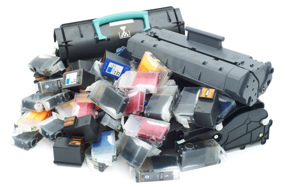 Pile of used toner and ink cartridges for printers