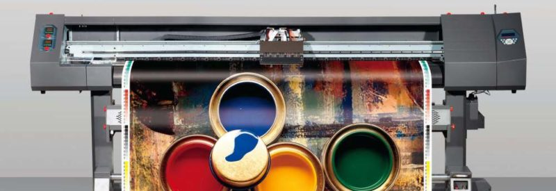 a wide format printer printing a colorful page