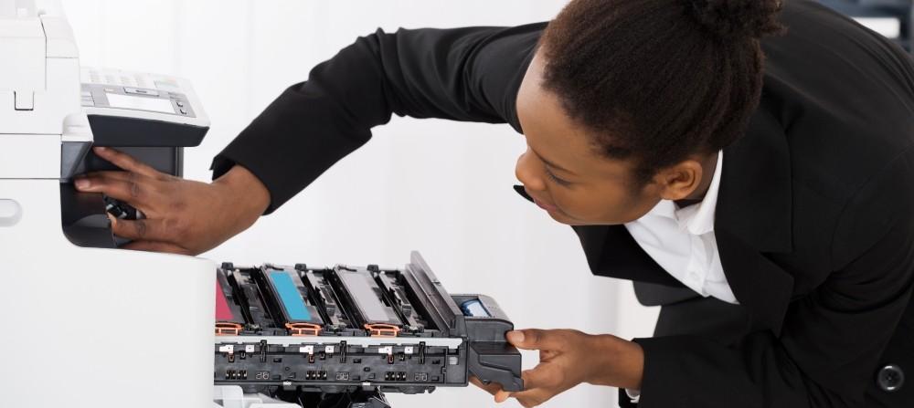 professional-woman-repairing-office-printer