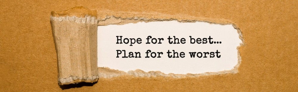 Paper peeled back to reveal the words hope for the best plan for the worst