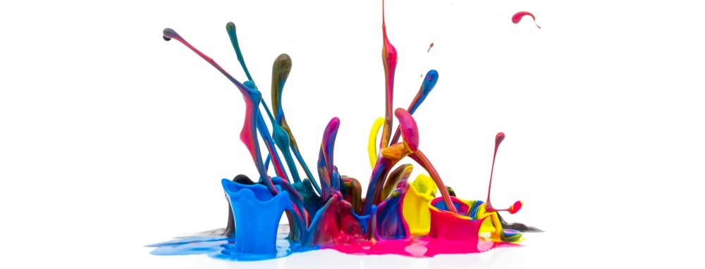 numerous colors of ink splashing off the floor