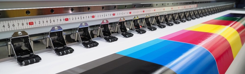 wide format printer printing a colorful banner