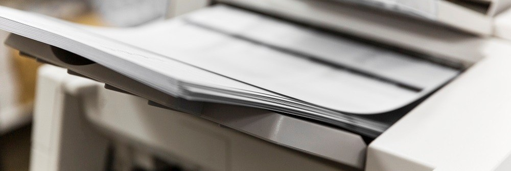 Stack of paper in a scanner tray